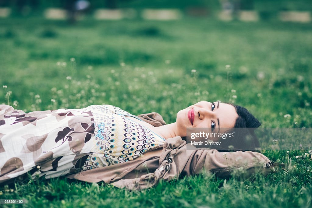 Relaxed woman among nature : Stock Photo