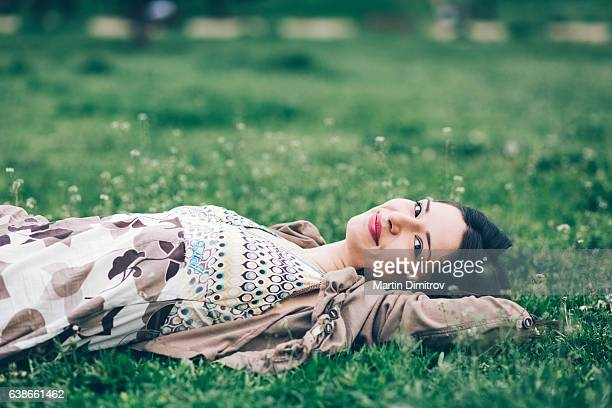 relaxed woman among nature - lying down foto e immagini stock