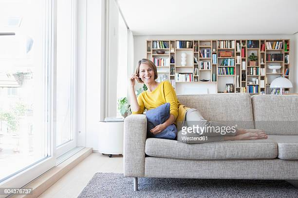 Relaxed woman at home on couch