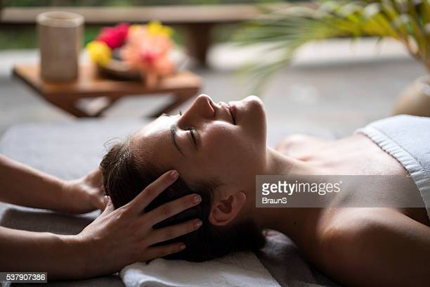relaxed woman enjoying in a head massage at the spa. - head massage stock photos and pictures