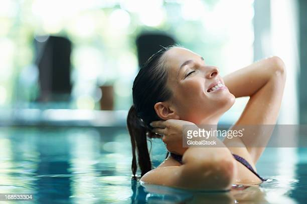 relaxed woman in pool - health farm stock pictures, royalty-free photos & images