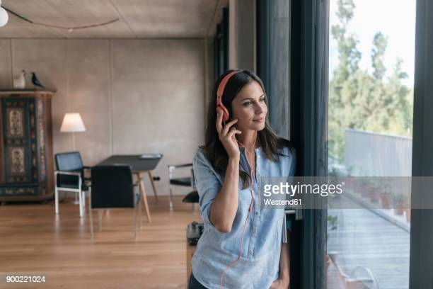 relaxed woman listening to music at home - blouse stock pictures, royalty-free photos & images