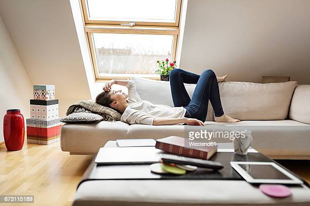 Relaxed woman lying on couch