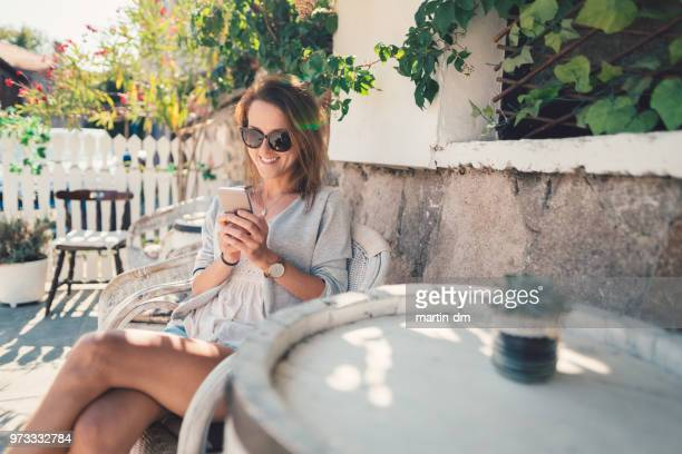 relaxed woman on summer vacation resting at the veranda - candid forum stock pictures, royalty-free photos & images