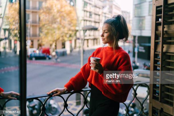 relaxed woman on the terrace - enjoyment stock pictures, royalty-free photos & images