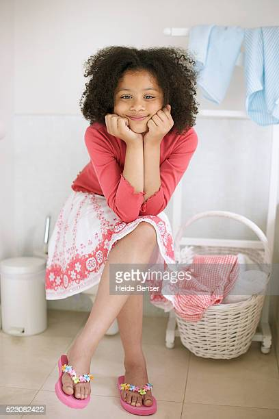 relaxed young girl sitting - black skirt stock pictures, royalty-free photos & images