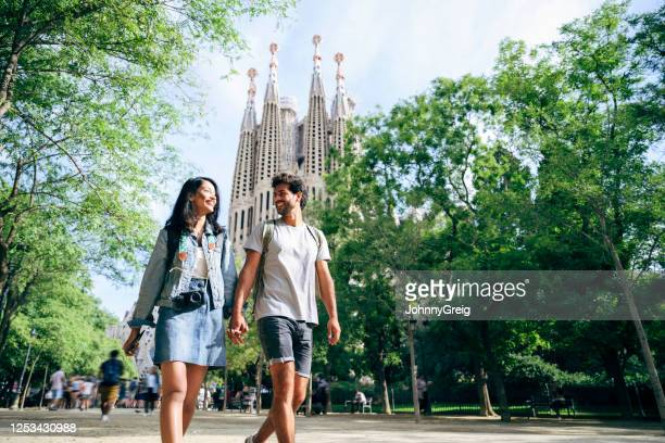 relaxed young tourists on weekend city break in barcelona - heterosexual couple stock pictures, royalty-free photos & images