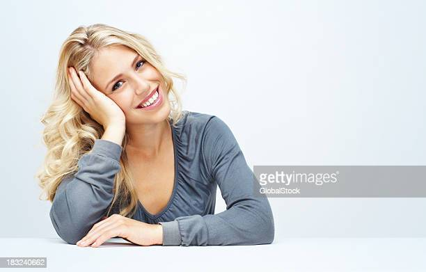 Relaxed young woman against white background - copyspace