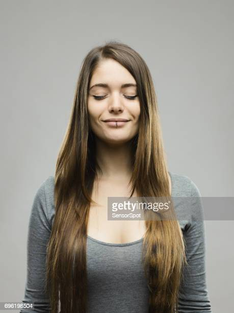 Relaxed young woman studio portrait