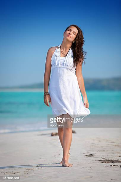 Relaxed young woman walking on a Tropical beach