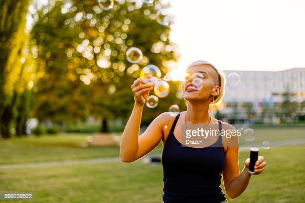 Relaxing activity in park with blowing bubbles