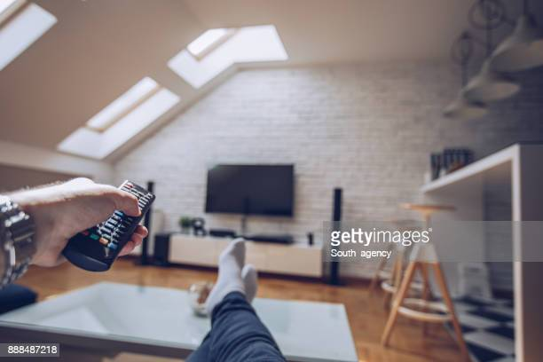 relaxing at home - tv housewife stock photos and pictures