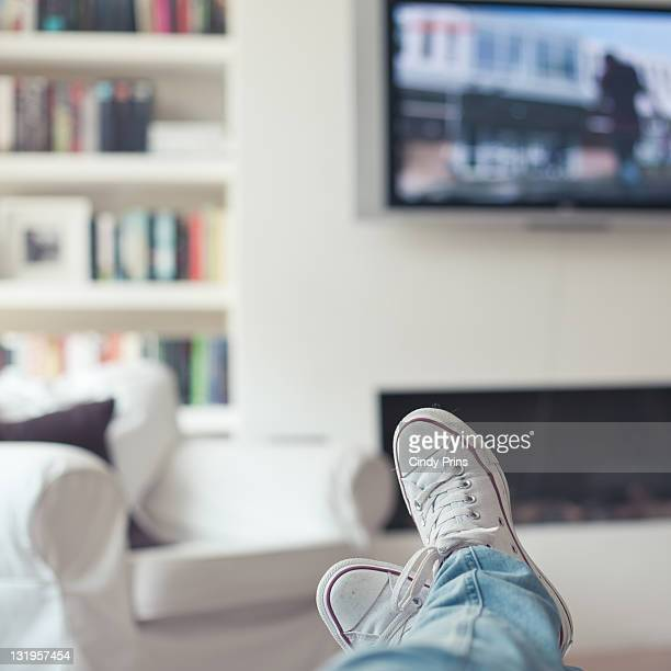 relaxing at home, watching tv - television show stock pictures, royalty-free photos & images