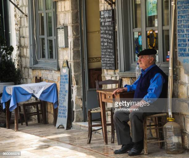 relaxing by the doorway - peloponnese stock photos and pictures