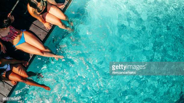 relaxing by the pool - hd format stock pictures, royalty-free photos & images