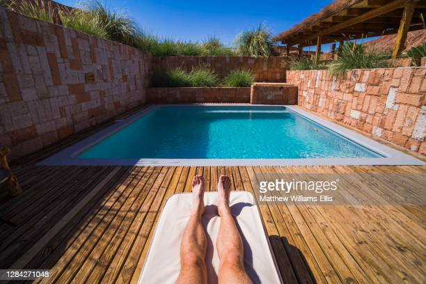 Relaxing by the swimming pool at Alto Atacama Desert Lodge and Spa, Atacama Desert, North Chile, South America.