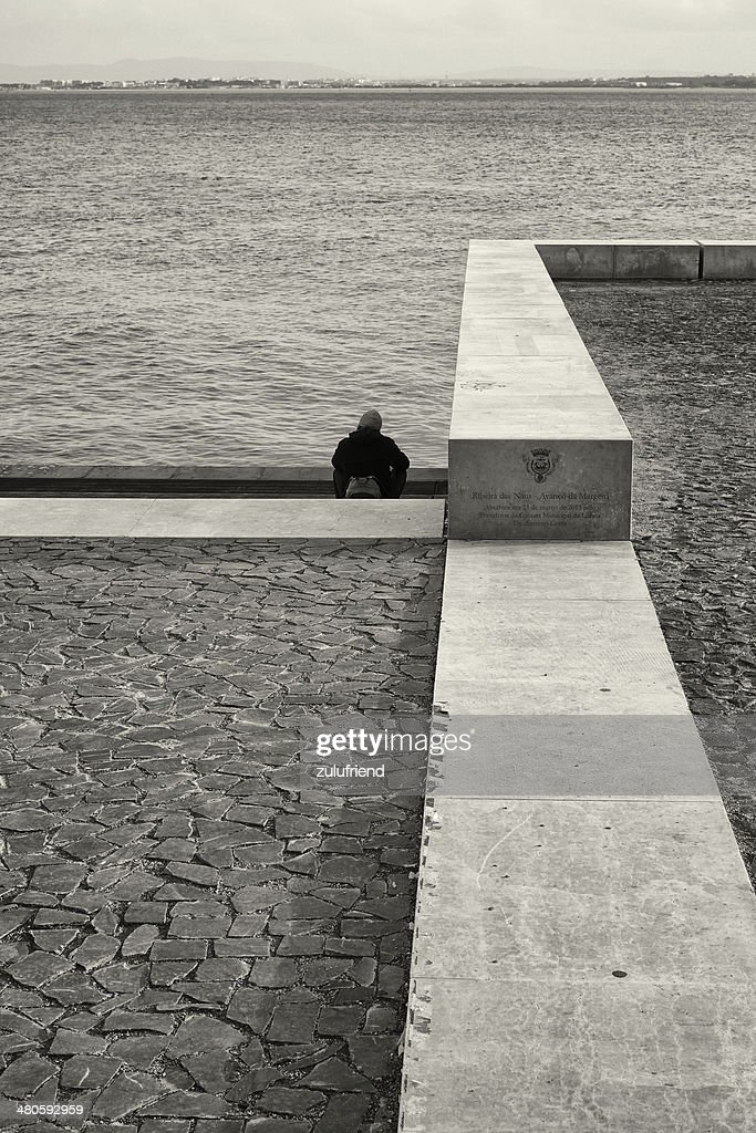 Relaxing by the Tagus River in Lisbon : Stock Photo
