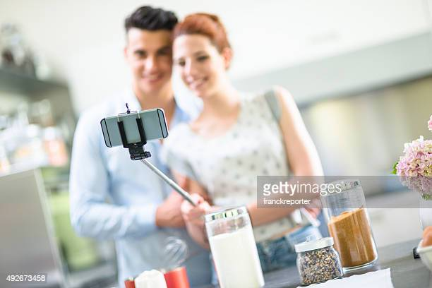 Relaxing couple on the kitchen cooking and take a selfie
