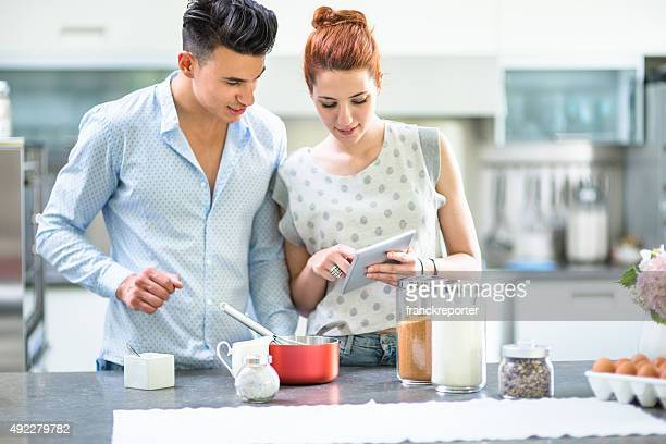Relaxing couple on the kitchen cooking
