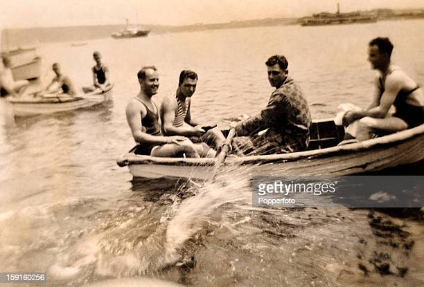 A relaxing day at Watson beach near Sydney for some of the MCC England cricket team with Bill Voce taking control of the oars circa January 1933 Also...