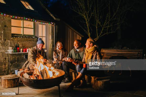 relaxing evening by the fire - fire pit stock pictures, royalty-free photos & images
