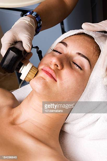 relaxing face treatment in spa - beauty care occupation stock photos and pictures