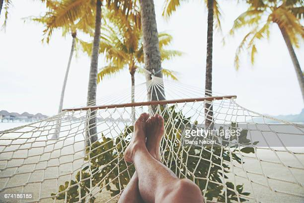 Relaxing feet on a beach hammock.