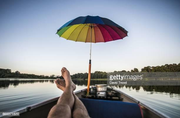relaxing in a canoe - subjektive kamera ungewöhnliche ansicht stock-fotos und bilder