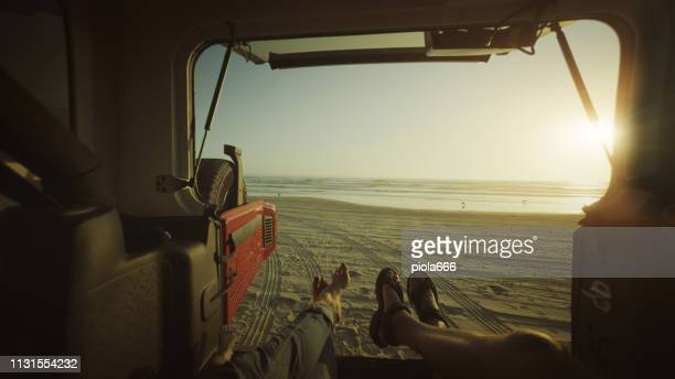 POV Relaxing in a car by the sea in a road trip