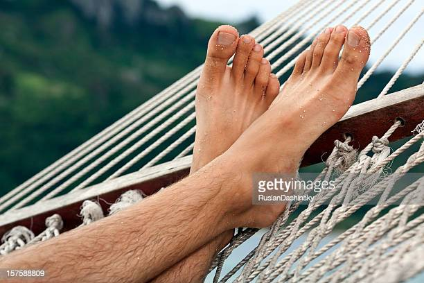 relaxing in a hammock - mens bare feet stock photos and pictures