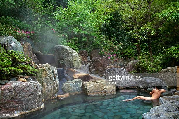 relaxing in a hot spring bath - 温泉 ストックフォトと画像
