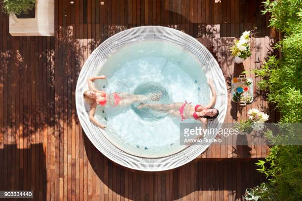 relaxing in a hot tub - hot tub stock photos and pictures