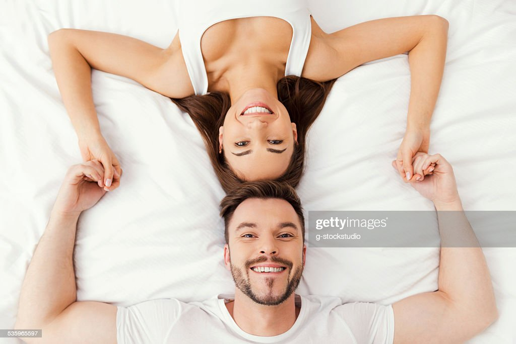 Relaxing in bed together. : Stock Photo
