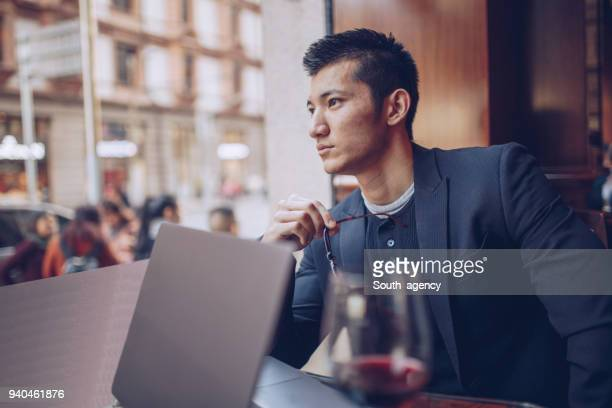 relaxing in coffee shop - one man only stock pictures, royalty-free photos & images