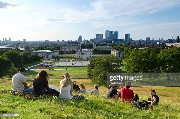 relaxing in greenwich park overlooking london - greenwich london stock pictures, royalty-free photos & images