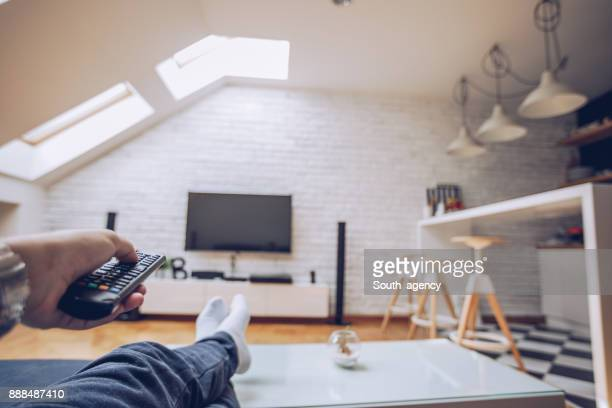 relaxing in living room - tv housewife stock photos and pictures