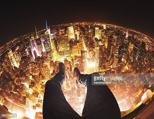 relaxing in new york city on top of a building - high up stock pictures, royalty-free photos & images