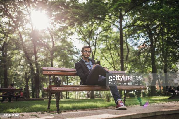 relaxing in park - cross legged stock pictures, royalty-free photos & images