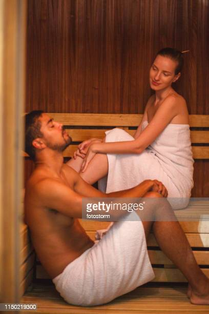 relaxing in sauna - black woman in sauna stock pictures, royalty-free photos & images