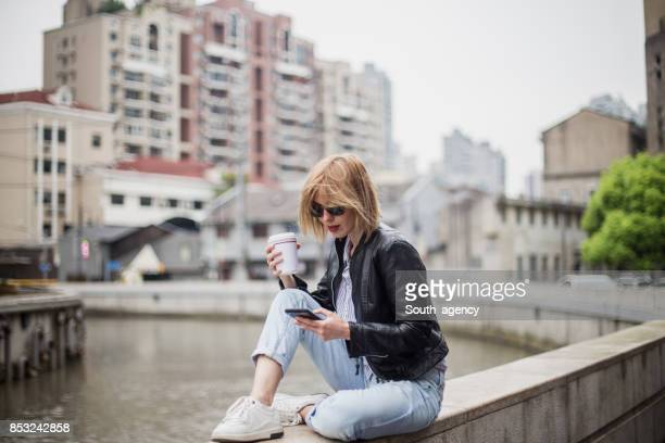 relaxing in the city - biker jacket stock photos and pictures