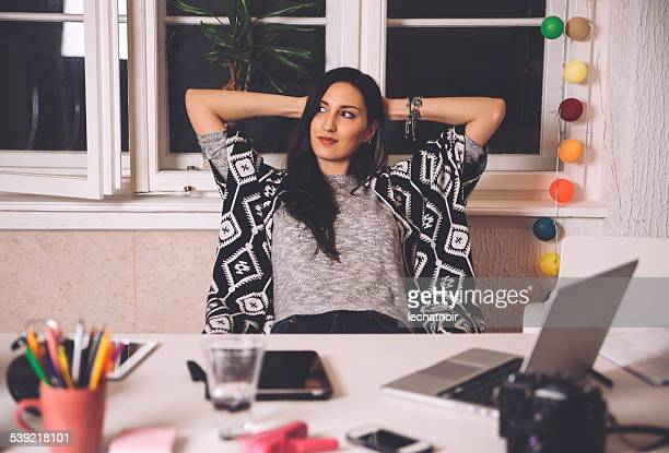 relaxing in the creative office space - photographic film camera stock photos and pictures