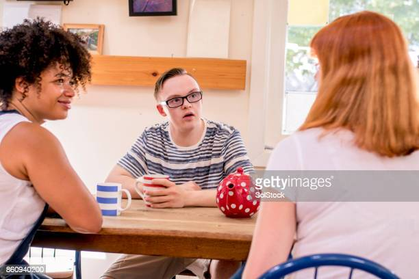 relaxing in the farm cafe - developmental disability stock photos and pictures