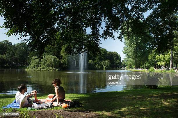 relaxing in the park - utrecht stockfoto's en -beelden