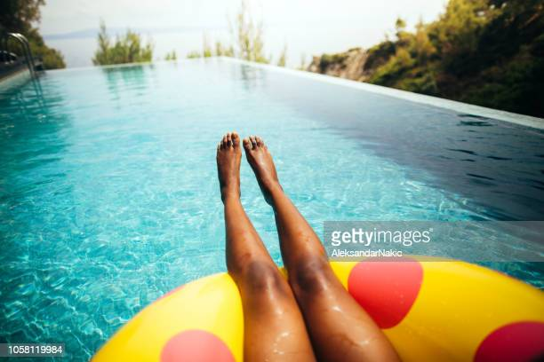 relaxing in the pool - hot legs stock photos and pictures