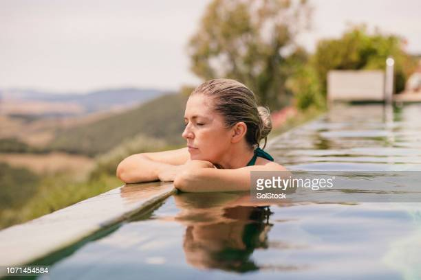 relaxing in the pool - poolside stock pictures, royalty-free photos & images