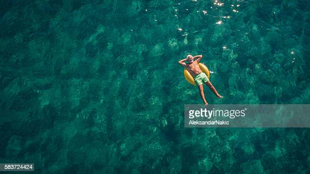 relaxing in the sea - carefree stock pictures, royalty-free photos & images