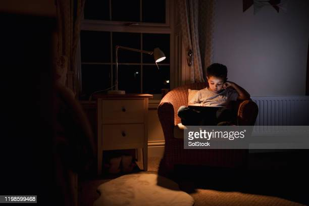 relaxing in the snug bedroom - bedroom stock pictures, royalty-free photos & images