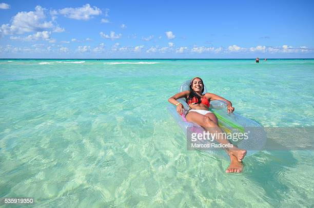 relaxing in the water, at cayo coco, cuba. - radicella stock pictures, royalty-free photos & images