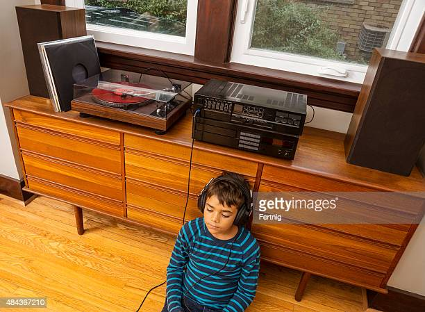 relaxing listening to tunes - old school. - hi fi stock pictures, royalty-free photos & images