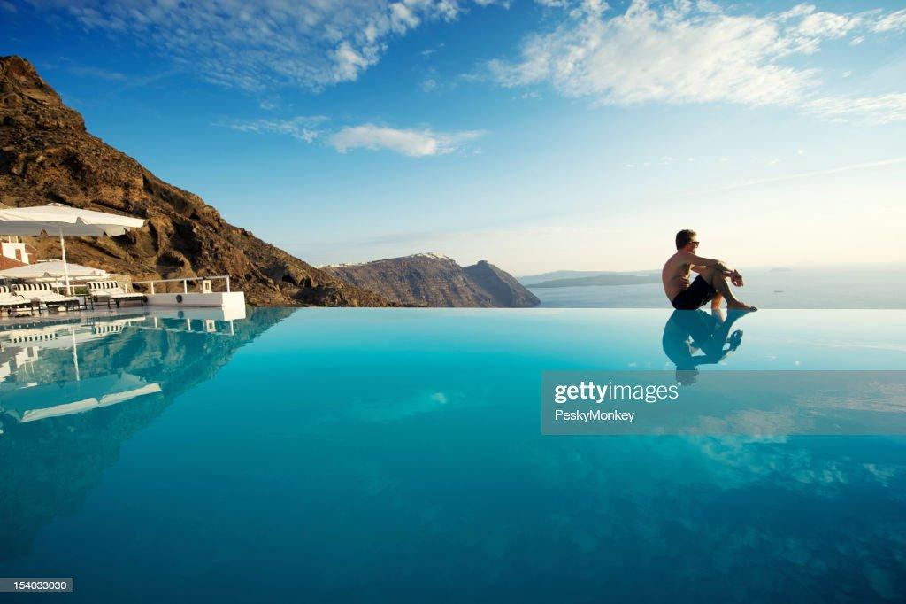 Relaxing Man Sitting Edge Luxury Resort Infinity Pool Santorini Greece : Stock Photo